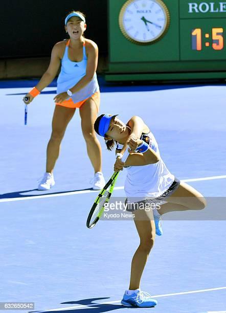 Japan's Miyu Kato and Eri Hozumi play against Bethanie MattekSands of the United States and Czech Lucie Safarova in the Australian Open women's...