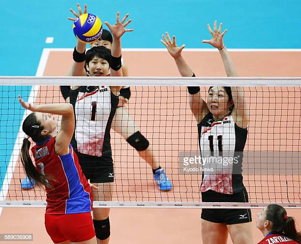 Japan's Miyu Nagaoka and Erika Araki attempt to block a spike during the first set of a preliminary round match against Russia at the Rio de Janeiro...