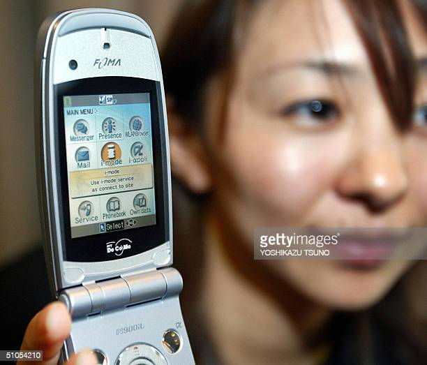 Japan's mobile communication giant NTT DoComo unveils the world' first dual network 3G mobile phone handset 'N900iL' produced by Japan's electronics...