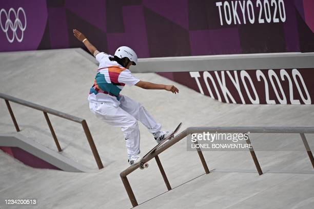 Japan's Momiji Nishiya competes in the skateboarding women's street final of the Tokyo 2020 Olympic Games at Ariake Sports Park in Tokyo on July 26,...