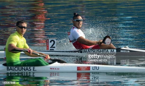 Japan's Momotaro Matsushita and Lithuania's Egidijus Balciunas arrive at the finish line in the kayak single 200m men's heats during the London 2012...