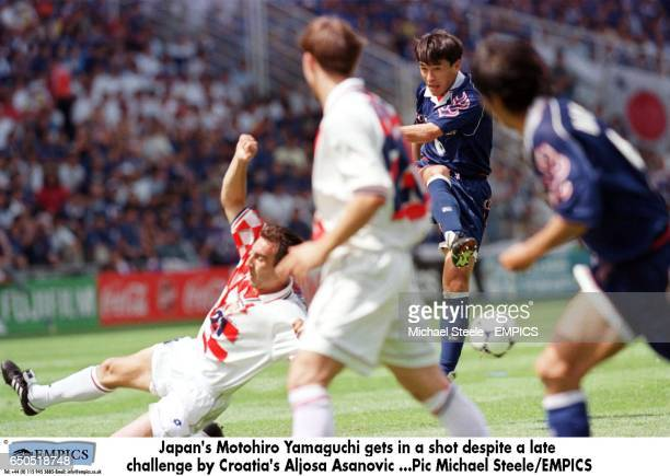 Japan's Motohiro Yamaguchi gets in a shot despite a late challenge by Croatia's Aljosa Asanovic