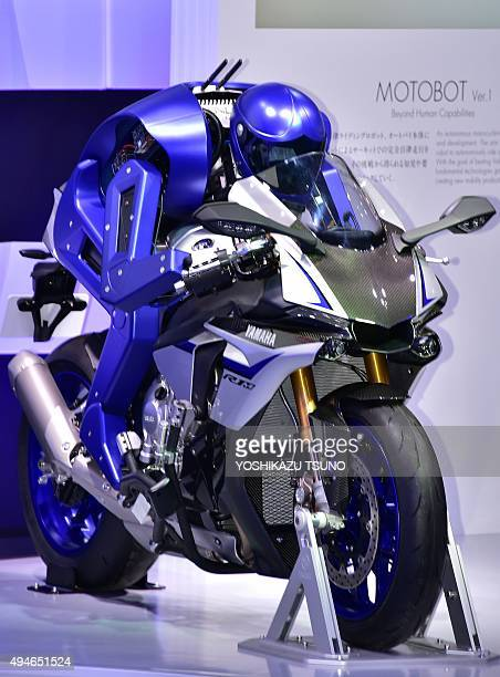 Japan's motorcycle maker Yamaha Motor introduces the prototype model of a motorcycle riding robot Motobot during a press preview at the Tokyo Motor...