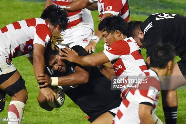 Japan's n°8 Asipeli Moala collapses with Japan's players during the World union Rugby U20 Championship match between NewZealand and Japan at the Parc...
