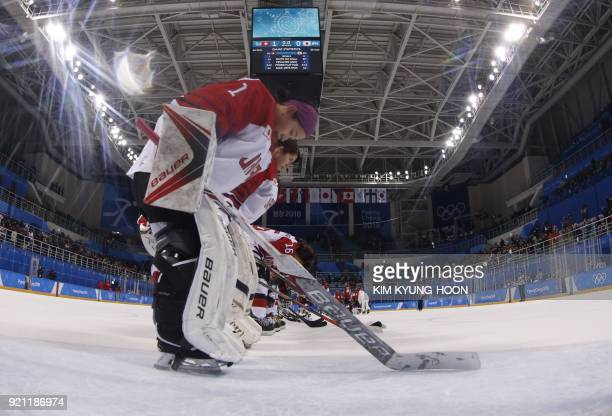 TOPSHOT Japan's Nana Fujimoto and other players bow after their loss in the women's playoff classifications ice hockey match between Switzerland and...