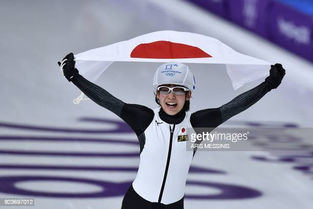 Japan's Nana Takagi celebrates after winning the women's mass start final speed skating event during the Pyeongchang 2018 Winter Olympic Games at the...
