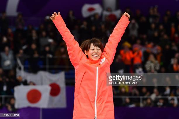 TOPSHOT Japan's Nana Takagi celebrates her gold medal win on the podium during the women's mass start speed skating event medal ceremony during the...