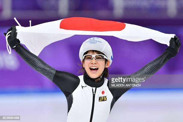 TOPSHOT Japan's Nana Takagi celebrates winning the women's mass start final speed skating event during the Pyeongchang 2018 Winter Olympic Games at...
