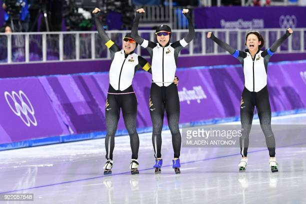 Japan's Nana Takagi, Japan's Miho Takagi and Japan's Ayano Sato reacts after competing in the women's team pursuit final A speed skating event during...