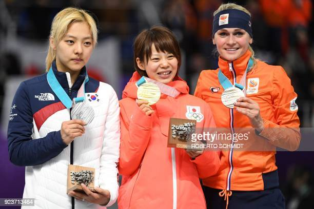 TOPSHOT Japan's Nana Takagi South Korea's Kim BoReum and Netherlands' Irene Schouten celebrate their respective gold silver and bronze medals on the...