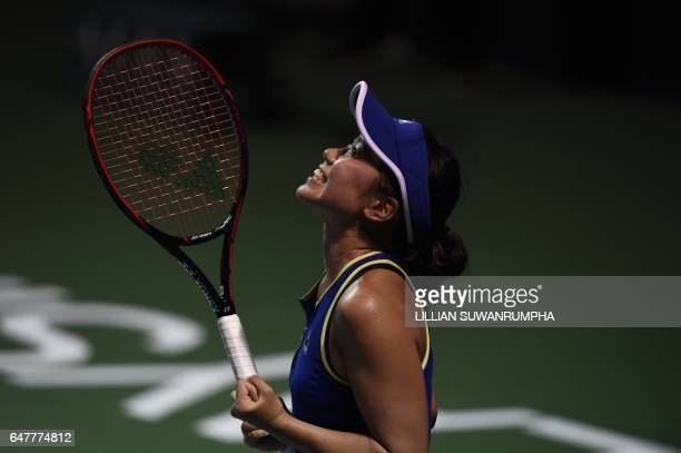 Japan's Nao Hibino celebrates after defeating Poland's Magda Linette during their women's singles semi-finals match of the WTA Malaysian Open tennis...