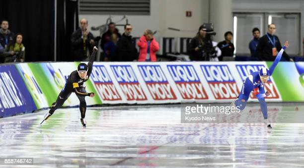 Japan's Nao Kodaira and Lee Sang Hwa of South Korea race off in the women's 500 meters at the speed skating World Cup in Salt Lake City Utah on Dec 8...