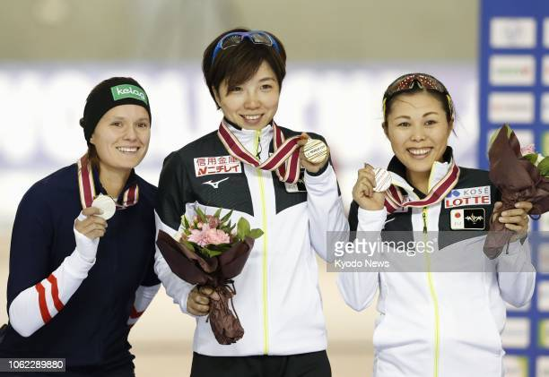 Japan's Nao Kodaira poses with her gold medal after winning the women's 500meter race in the World Cup opener in Obihiro Hokkaido on Nov 16 along...