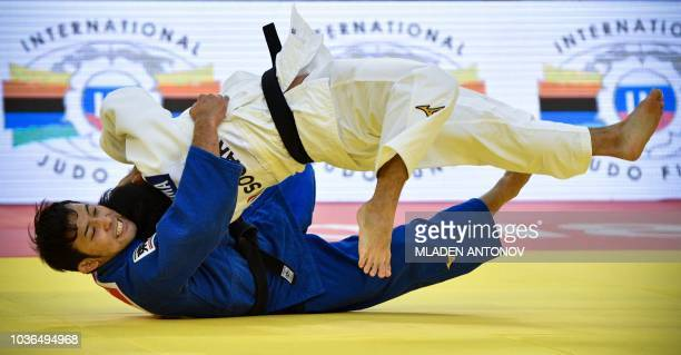 Japan's Naohisa Takato fights against Japan's Ryuju Nagayama during the under 60kg men category of the 2018 Judo World Championships in Baku on...