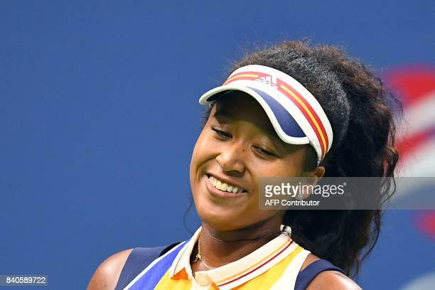 Japans Naomi Osaka celebrates after defeating Germanys Angelique Kerber during their 2017 US Open Women's Singles match at the USTA Billie Jean King...