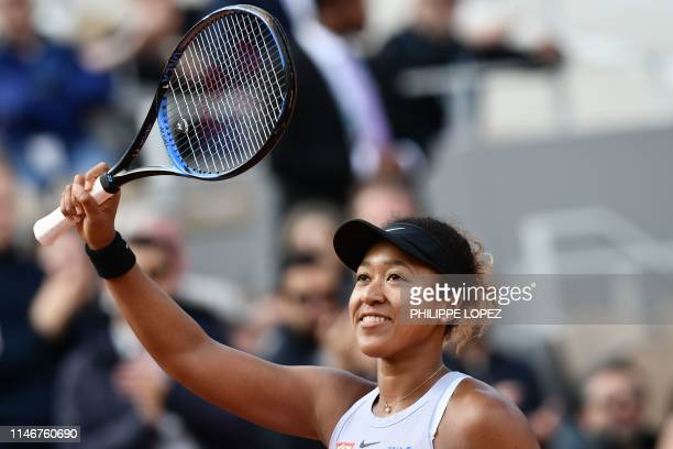 TOPSHOT Japan's Naomi Osaka celebrates after winning against Slovakia's Anna Karolina Schmiedlova at the end of their women's singles first round...