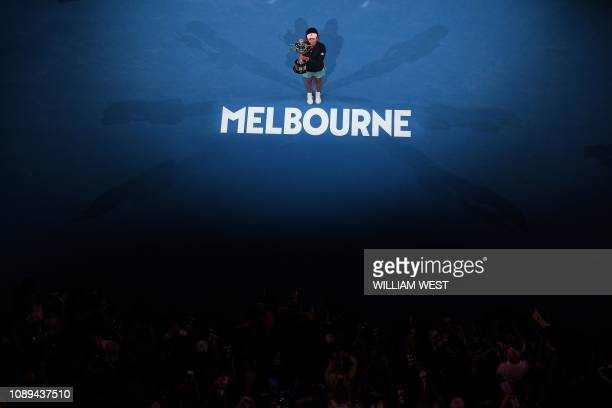 Japan's Naomi Osaka celebrates with the championship trophy during the presentation ceremony after her victory against Czech Republic's Petra Kvitova...