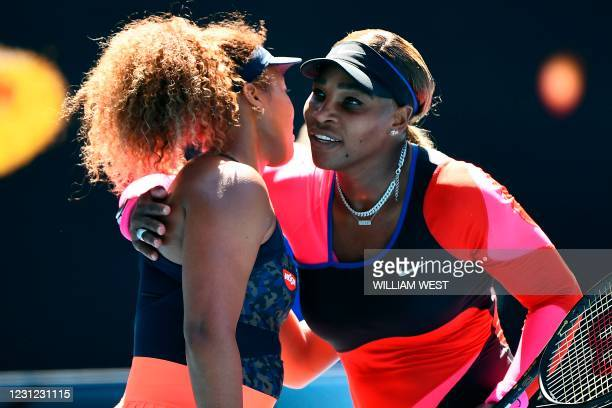 Japan's Naomi Osaka gives a hug to Serena Williams of the US after their women's singles semi-final match on day eleven of the Australian Open tennis...