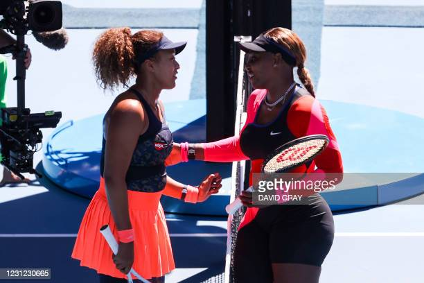 Japan's Naomi Osaka greets Serena Williams of the US at the end of their women's singles semi-final match on day eleven of the Australian Open tennis...