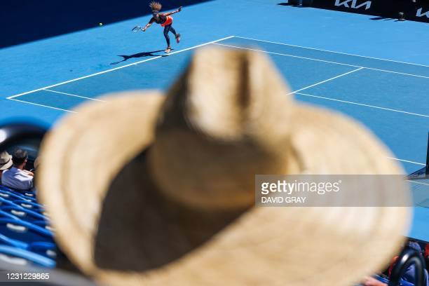 Japan's Naomi Osaka hits a return against Serena Williams of the US during their women's singles semi-final match on day eleven of the Australian...