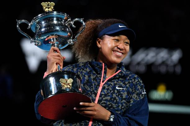 Japan's Naomi Osaka holds the Daphne Akhurst Memorial Cup trophy after beating Jennifer Brady of the US to win their women's singles final match on...
