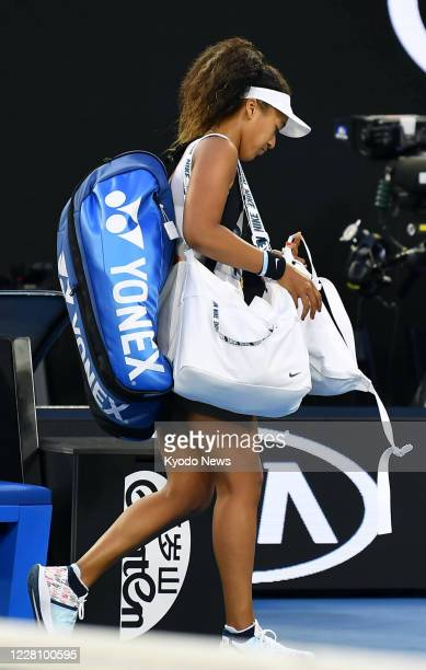 Japan's Naomi Osaka leaves the court after losing to Coco Gauff of the United States in a women's singles thirdround match at the Australian Open...