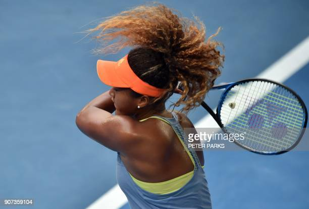 TOPSHOT Japan's Naomi Osaka plays a backhand return to Australia's Ashleigh Barty during their women's singles third round match on day six of the...