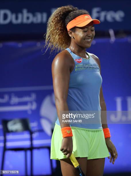 Japan's Naomi Osaka reacts after scoring against France's Kristina Mladenovic during day one of the WTA Dubai Duty Free Tennis Championship at the...