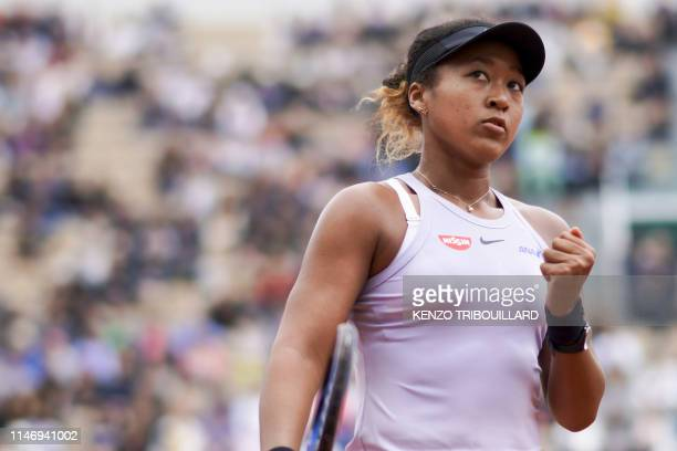 Japan's Naomi Osaka reacts after winning a point against Belarus' Victoria Azarenka during their women's singles second round match on day five of...