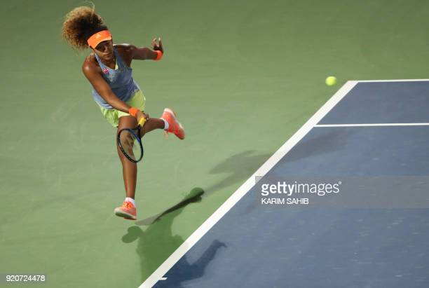 Japan's Naomi Osaka returns the ball to France's Kristina Mladenovic during day one of the WTA Dubai Duty Free Tennis Championship at the Dubai...