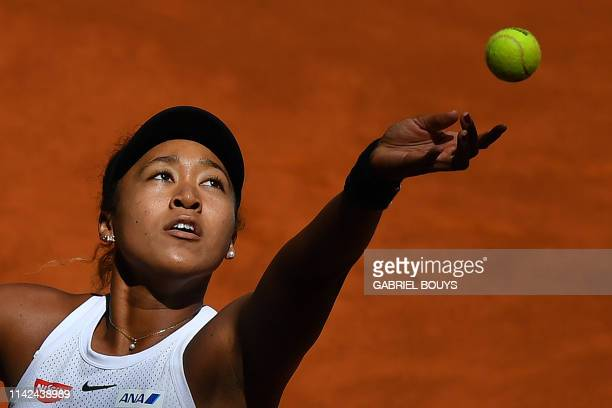 Japan's Naomi Osaka returns the ball to Switzerland's Belinda Bencic during their WTA Madrid Open round of 8 tennis match at the Caja Magica in...