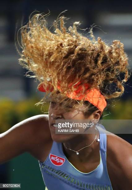 Japan's Naomi Osaka serves the ball to France's Kristina Mladenovic during day one of the WTA Dubai Duty Free Tennis Championship at the Dubai Tennis...