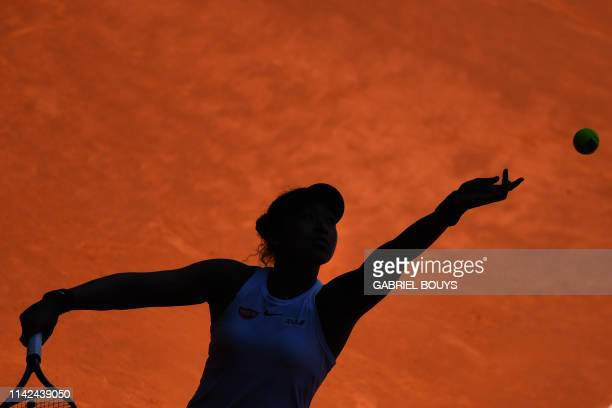 TOPSHOT Japan's Naomi Osaka serves the ball to Switzerland's Belinda Bencic during their WTA Madrid Open round of 8 tennis match at the Caja Magica...