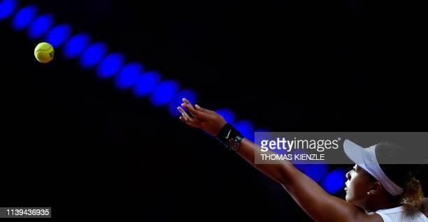 Japan's Naomi Osaka serves to Croatia's Donna Vekic during their quarterfinal match at the WTA Tennis Grand Prix in Stuttgart, southwestern Germany,...