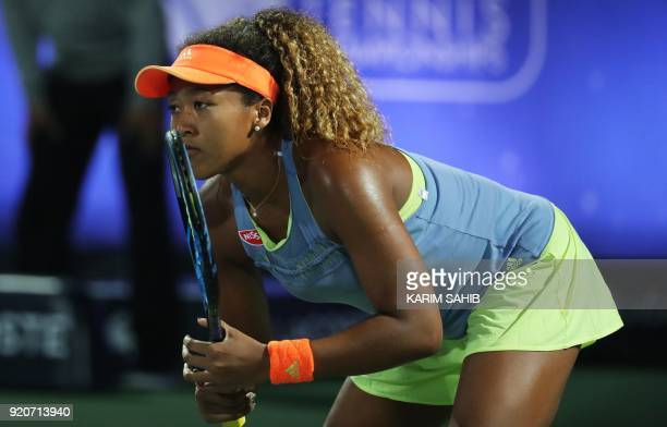 Japan's Naomi Osaka waits for return the serve of France's Kristina Mladenovic during day one of the WTA Dubai Duty Free Tennis Championship at the...