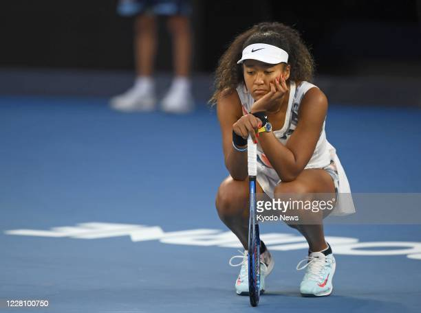 Japan's Naomi Osaka waits for the result after challenging an umpire's call during her women's singles thirdround match against Coco Gauff of the...