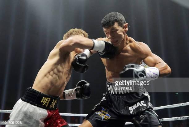 TOPSHOT Japan's Naoya Inoue and Juan Carlos Payano of Dominican Republic fight during their WBA world bantamweight title match in Yokohama Kanagawa...