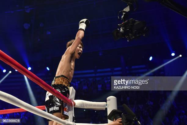 TOPSHOT Japan's Naoya Inoue celebrates his win over Great Britain's Jamie McDonnell during their WBA world bantamweight title boxing bout in Tokyo on...