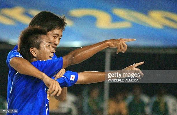 Japan's Naoyuki Kuroki and Naoya Oshiro celebrate after scoring against US during their Fifa Beach-Soccer World Cup match 09 May, 2005 at Copacabana...