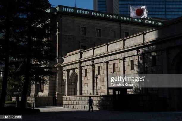 Japan's national flag flies atop the Bank of Japan building on November 12, 2019 in Tokyo, Japan.