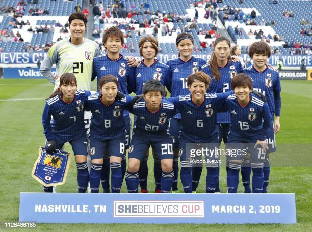 Japan's national football players pose for a photo before a match against Brazil at the SheBelieves Cup women's football tournament in Nashville...