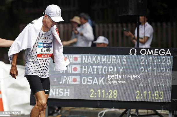 Japan's national record holder Suguru Osako reacts after finishing third in the men's marathon at the Marathon Grand Championship in Tokyo on Sept 15...