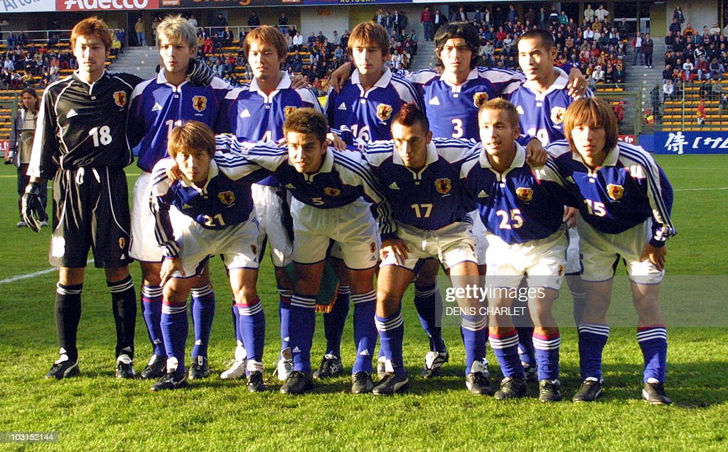 ece573cfd Japan s national soccer team players pose for a group picture 04 ...