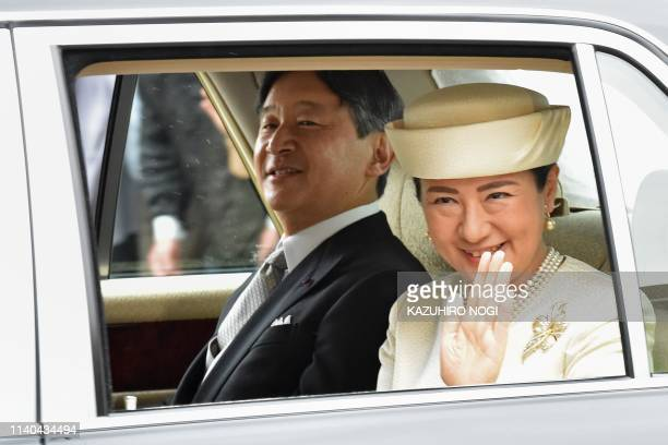 Japan's new Emperor Naruhito and Empress Masako arrive back at the Imperial Palace in Tokyo on May 1 2019 Japan's new Emperor Naruhito formally...