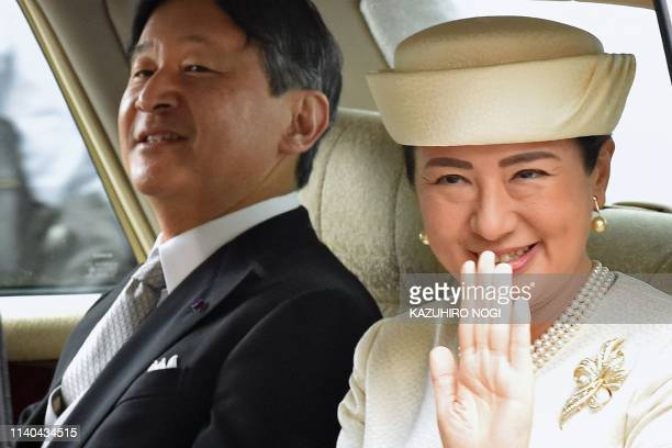 TOPSHOT Japan's new Emperor Naruhito and Empress Masako arrive back at the Imperial Palace in Tokyo on May 1 2019 Japan's new Emperor Naruhito...