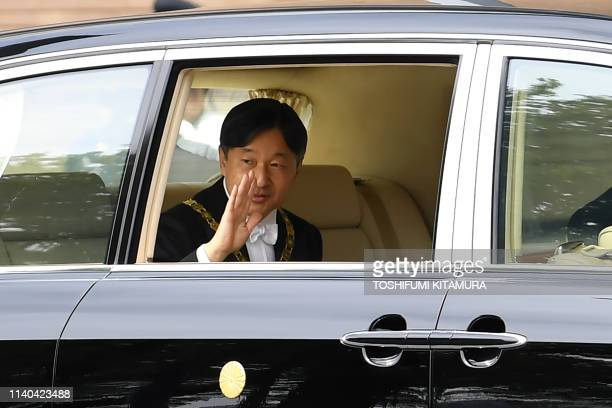Japans new Emperor Naruhito waves as he arrives at the Imperial Palace in Tokyo on May 1 2019 Japan's new emperor Naruhito will formally take over...