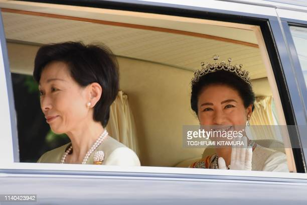 Japans new Empress Masako waves as she leaves the Imperial Palace in Tokyo on May 1, 2019. - Japan's new Emperor Naruhito formally ascended the...
