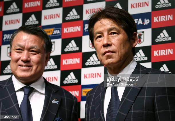 Japan's new head coach Akira Nishino and Japan Football Association President Kozo Tashima pose for photographs during a press conference at the JFA...