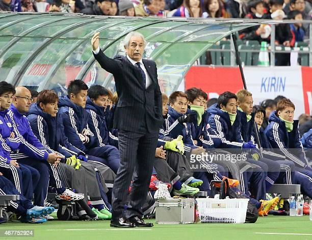 Japan's new head coach of Vahid Halilhodzic gestures instructions to Japanese players during the first half of the football international friendly...