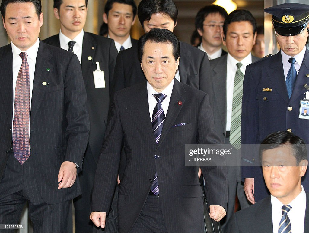 Japan's new Prime Minister Naoto Kan (C) is surrounded by guards in the parliament in Tokyo on June 4, 2010. New leader Naoto Kan on June 5, huddled with aides to choose a cabinet lineup that will help him tackle pressing challenges, from reviving Asia's top economy to mending strained US ties.